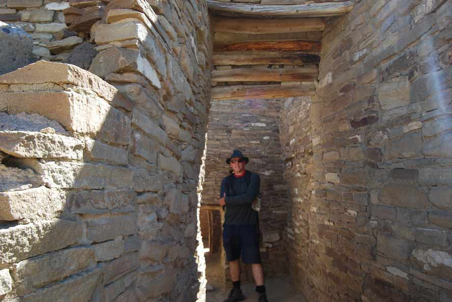 Photographer providing scale at Pueblo Bonito